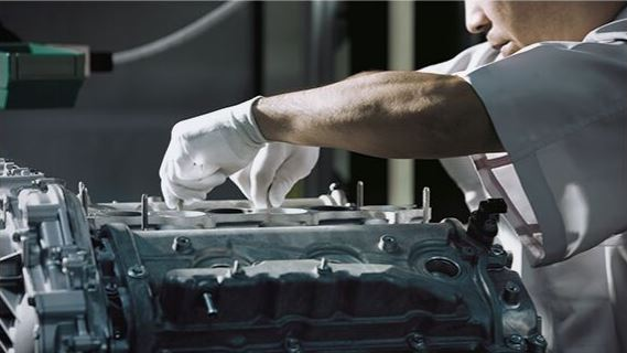 Nissan engineer working on engine